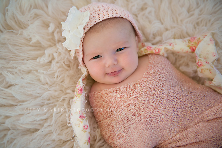 newborn baby girl smiling in frederick maryland