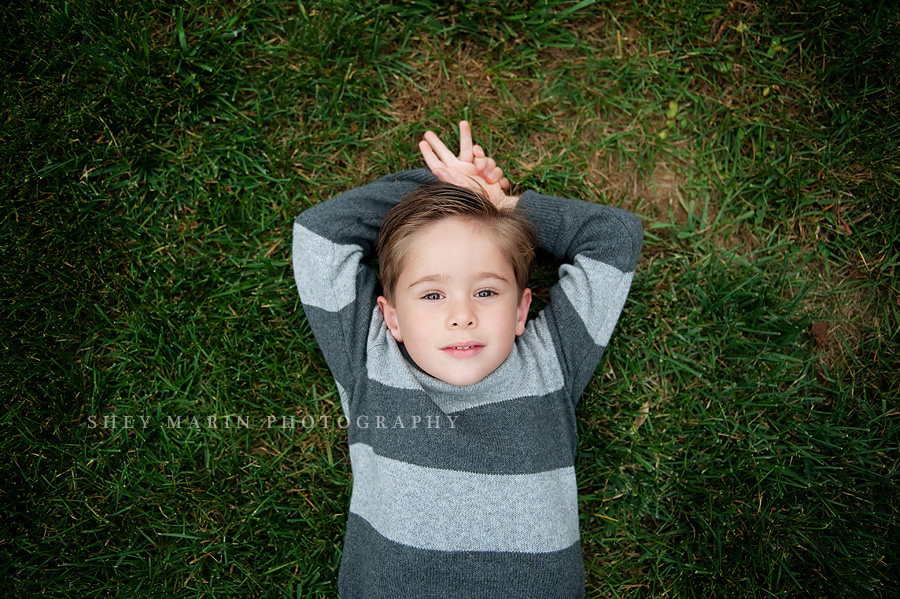 Frederick boy lying in grass