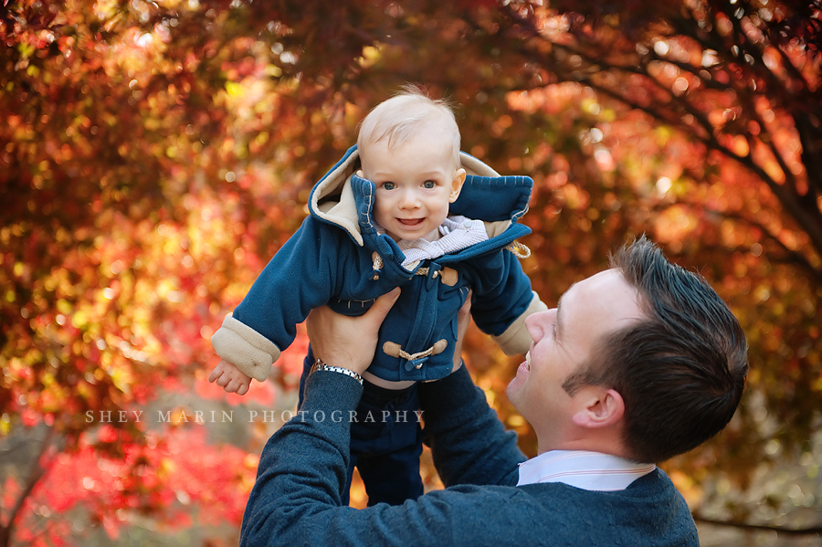 baby boy in red fall leaves in washington DC