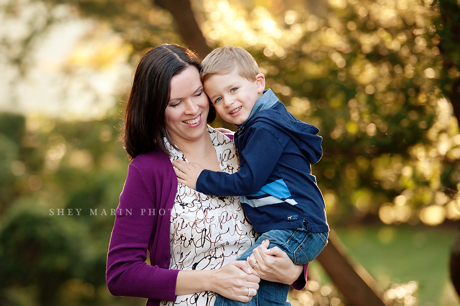 mom and little boy smiling together in maryland