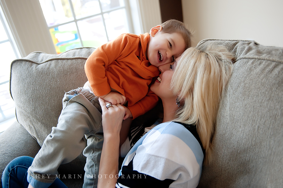 Mom and little boy snuggling in lifestyle photo session