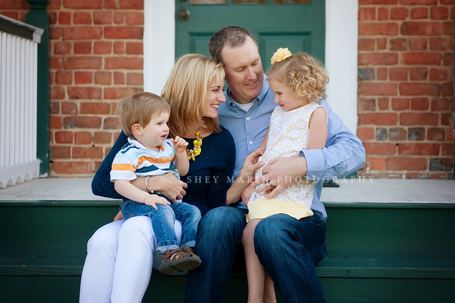 family sitting on steps laughing together