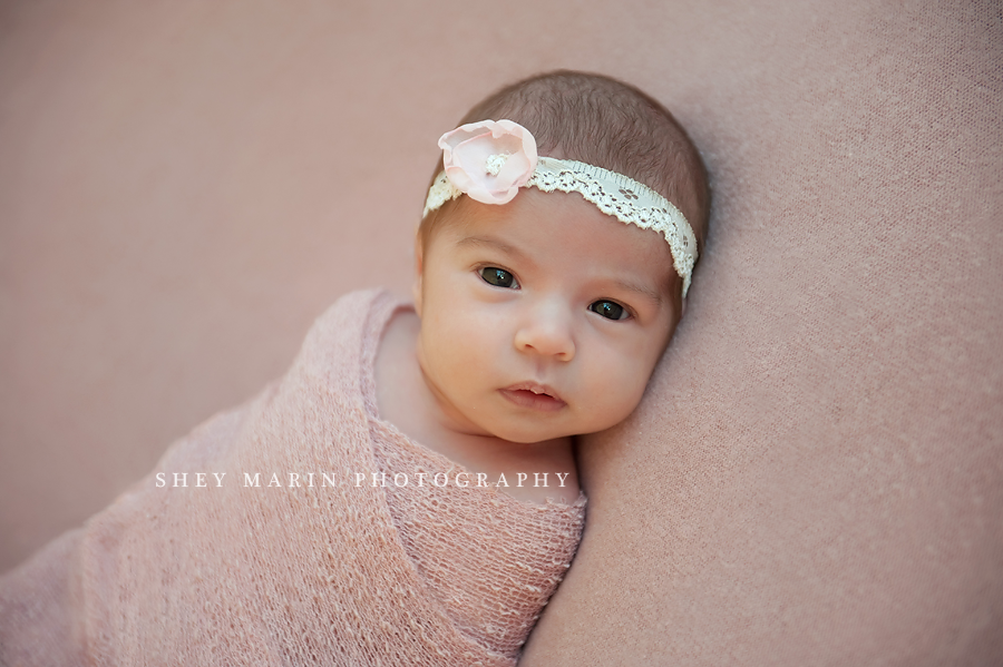 beautiful newborn girl looking at camera