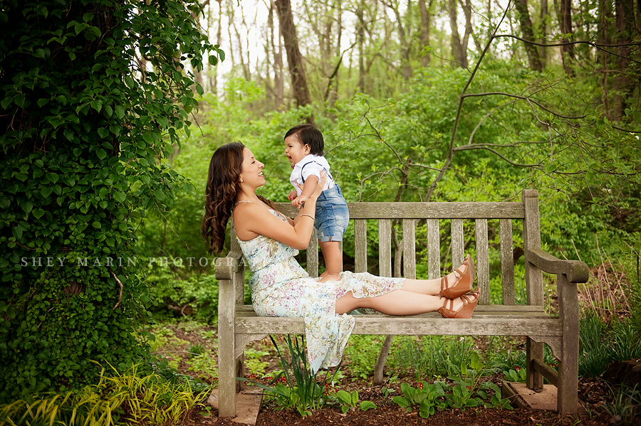 laughing boy and mom on a bench