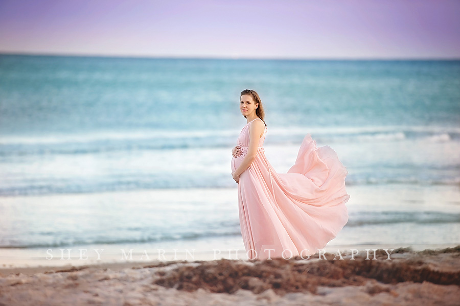 maternity session at the beach at sunset