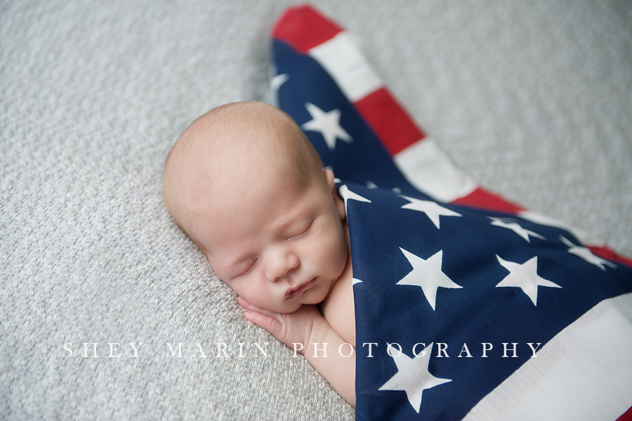 Newborn baby in american flag washington dc newborn baby maternity photographer maryland family photography