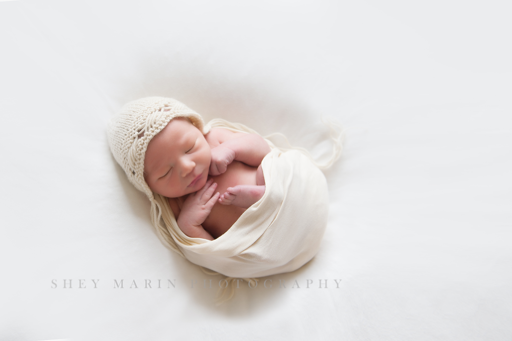 newborn baby on cream wrap in frederick maryland