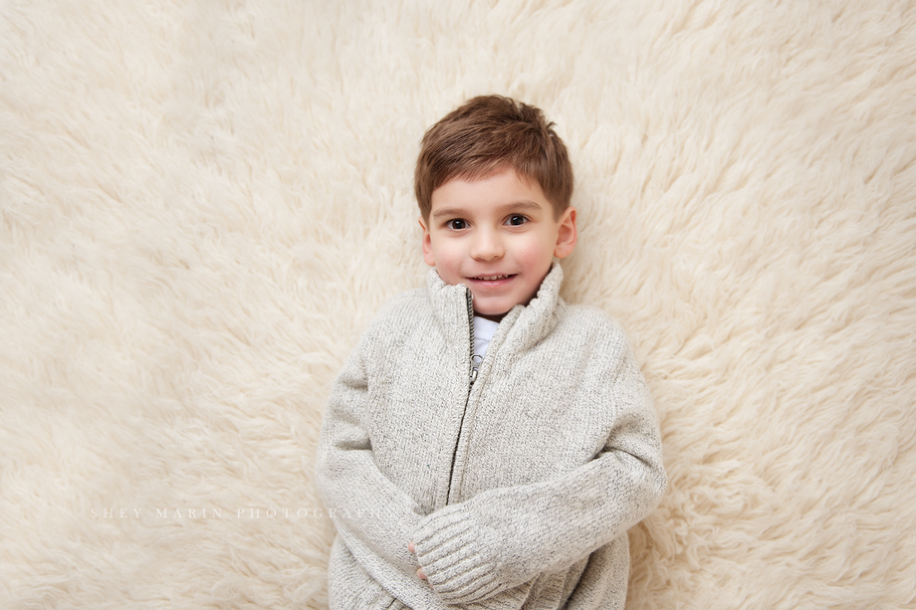 boy on rug in studio | frederick family photographer