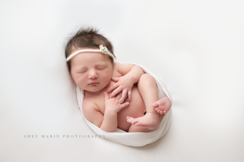 baby girl in white | Frederick Maryland newborn photographer