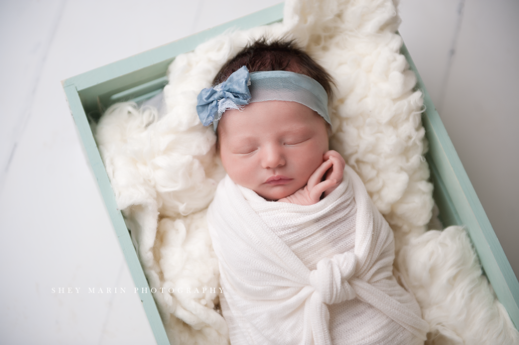 baby girl in blue | Frederick Maryland newborn photographer