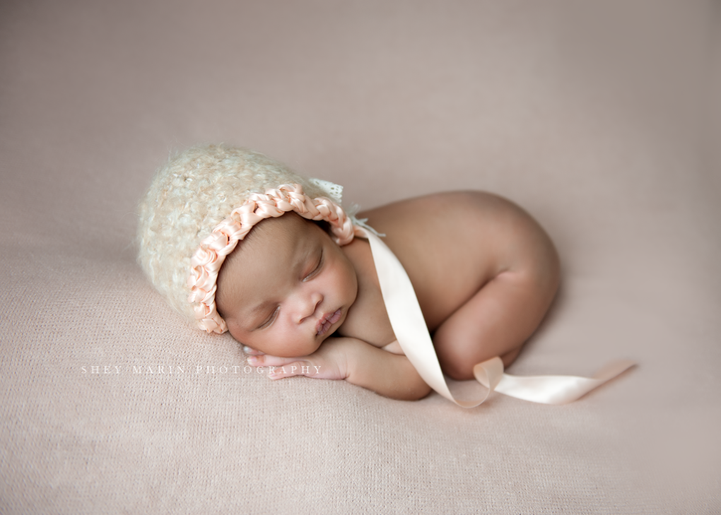 baby girl in pink bonnet | Washington DC newborn photographer