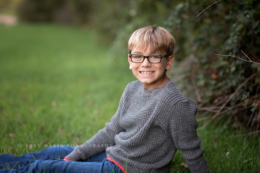 Frederick Maryland child with glasses photographed in meadow