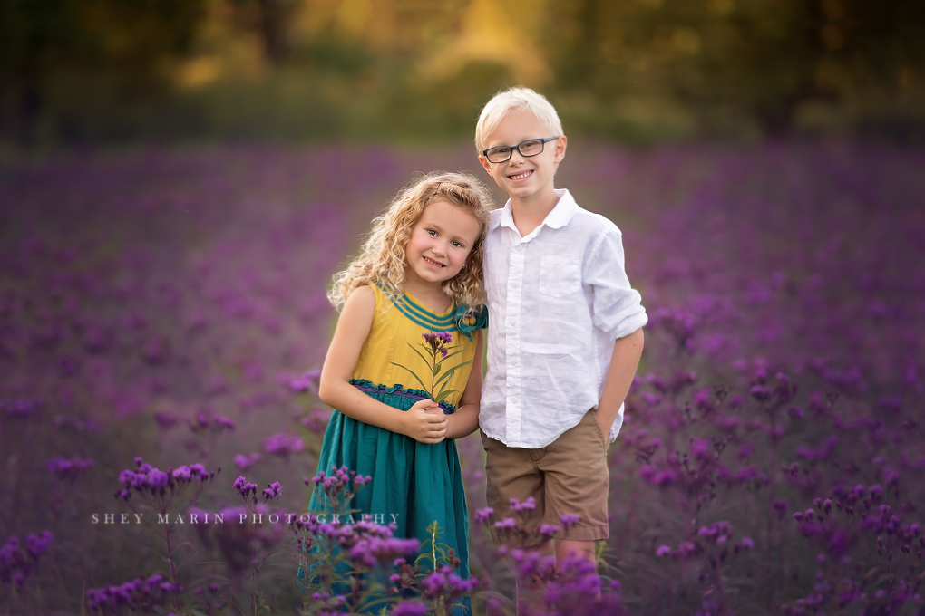 purple wildflower fields with two siblings | Frederick Maryland photographer